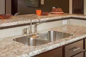 Undermount sink with a laminate top